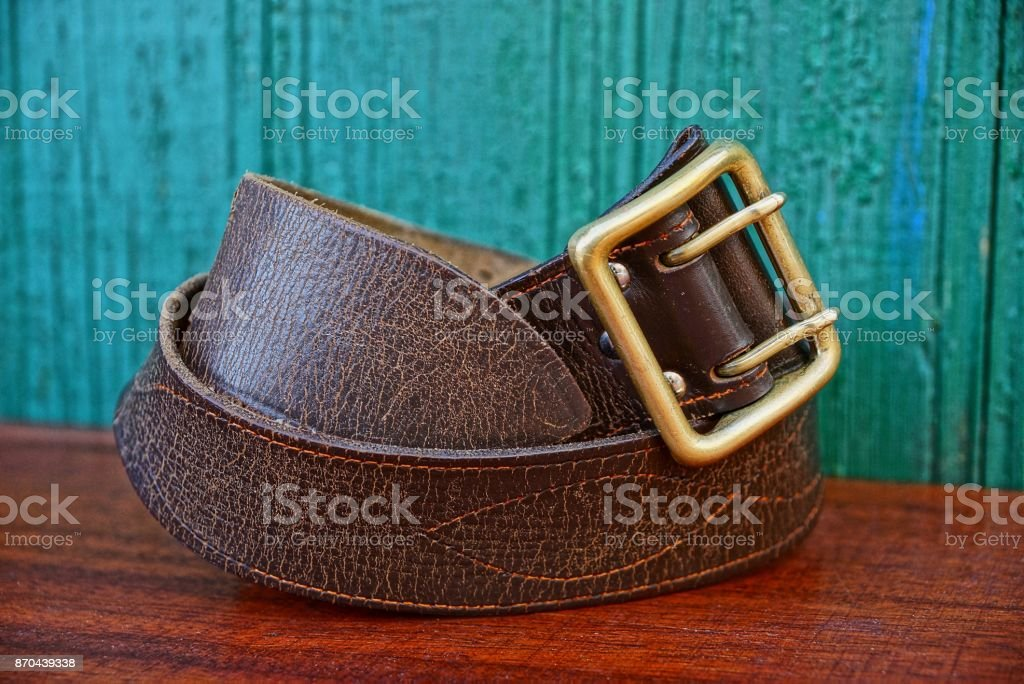 old brown army belt made of leather stock photo