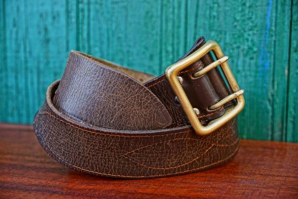 old brown army belt made of leather - belt stock photos and pictures