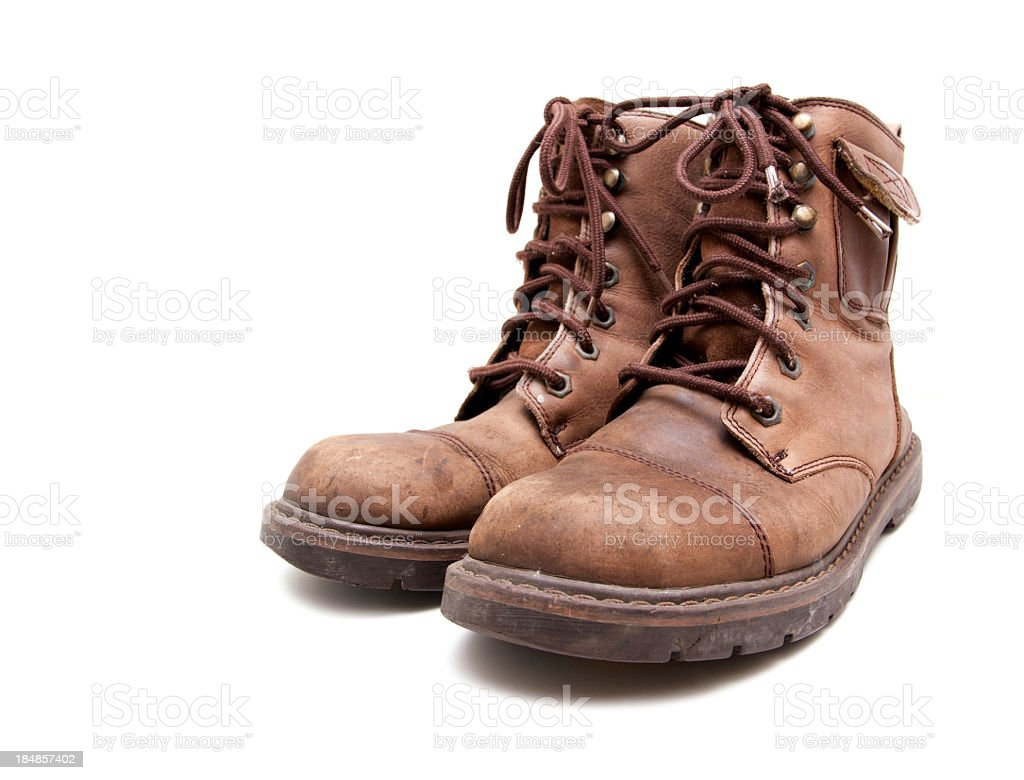 old brown boots isolated on white background stock photo