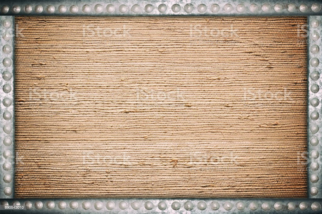 Old brown fabric background with metal rivets frame stock photo