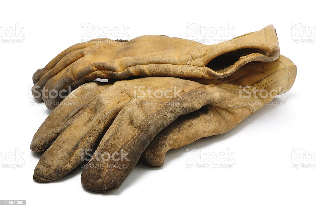 Old brown leather rigger work gloves on a white background stock photo