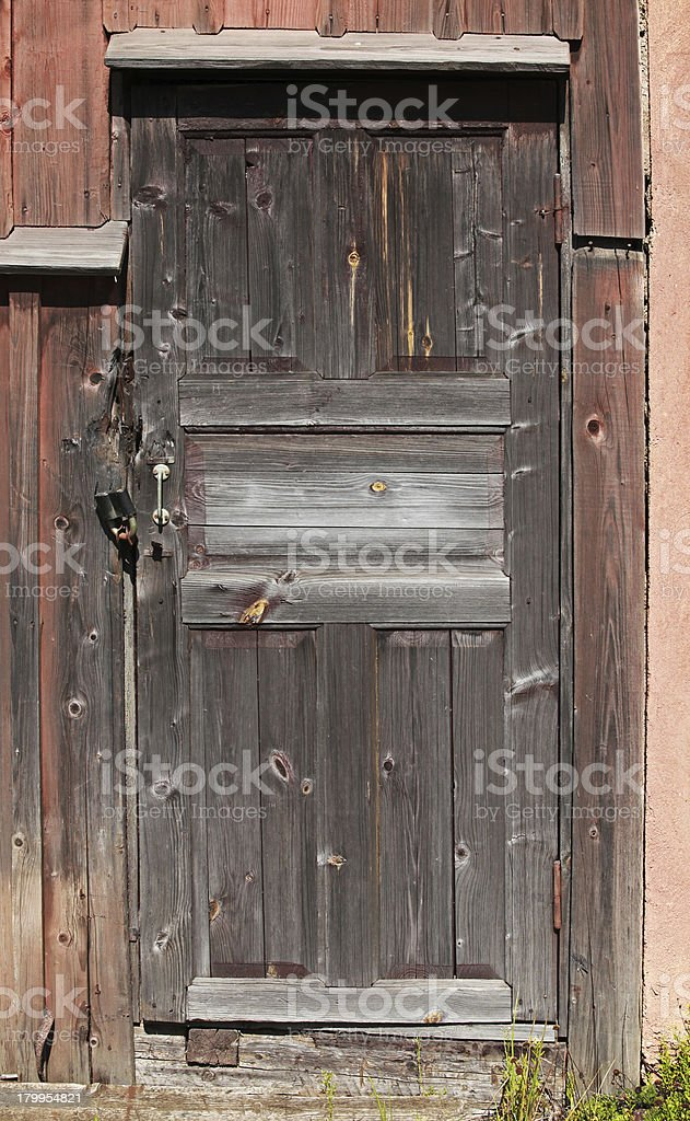 Old brown locked wooden door background texture royalty-free stock photo