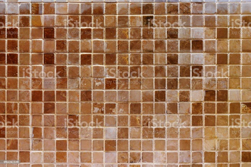 old brown mosaic wall. stock photo