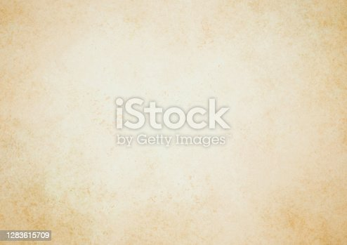 istock Old brown paper parchment background design with distressed vintage stains and ink spatter and white faded shabby center, elegant antique beige color 1283615709