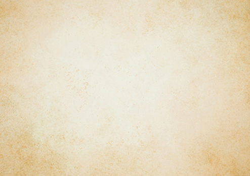 Old brown paper parchment background design with distressed vintage stains and ink spatter and white faded shabby center, elegant antique beige color
