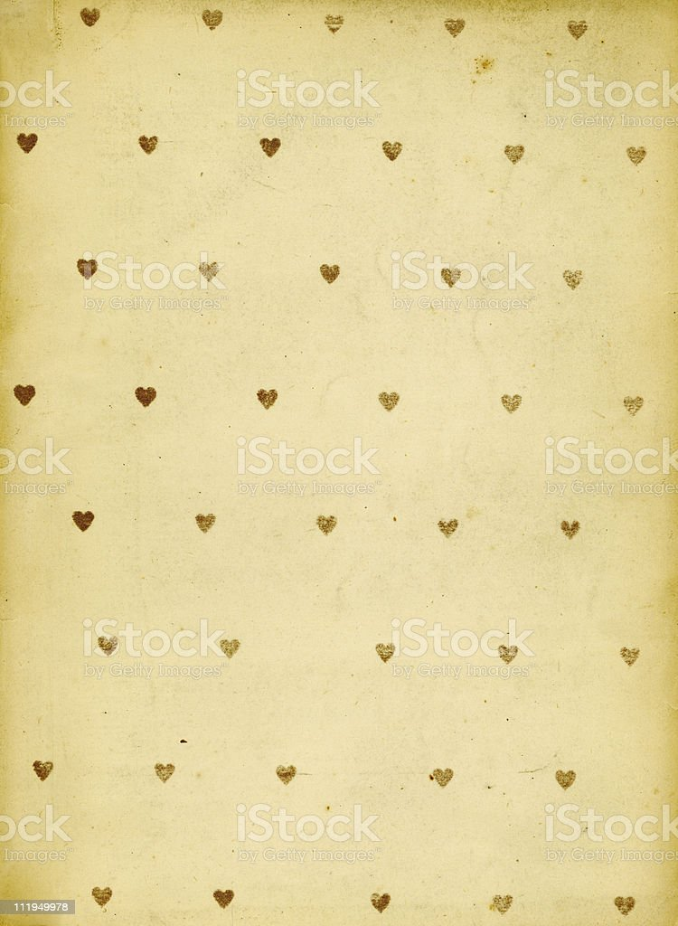 Old brown paper with golden hearts stock photo