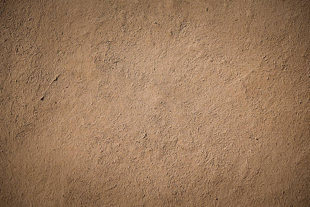 old brown stucco clay wall closeup detail of old brown stucco clay wall, rough surface background or backdrop in architectural material concept clay stock pictures, royalty-free photos & images