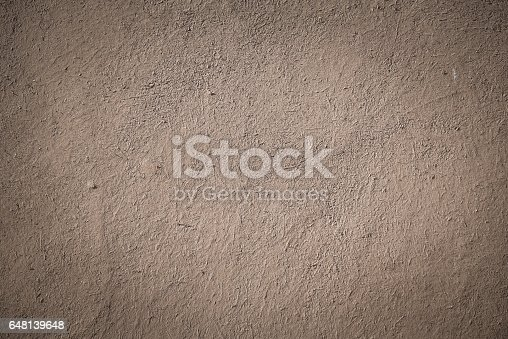 700531402 istock photo old brown stucco clay wall with vignette effect 648139648