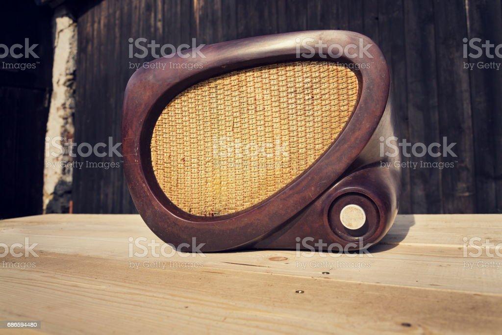 Old brown vintage bakelite radio on wooden background royalty-free stock photo