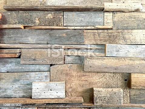 905087856istockphoto Old brown wood texture on the wall background 1098197302