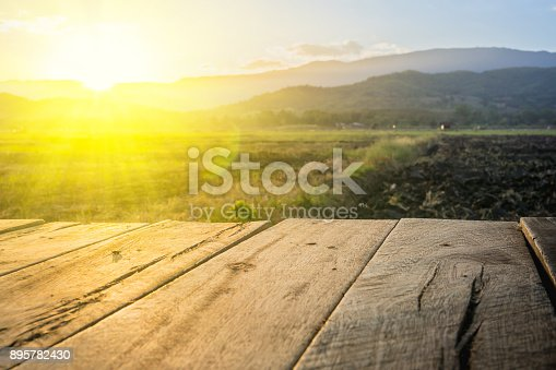 istock old brown wooden floor beside agricultural field 895782430