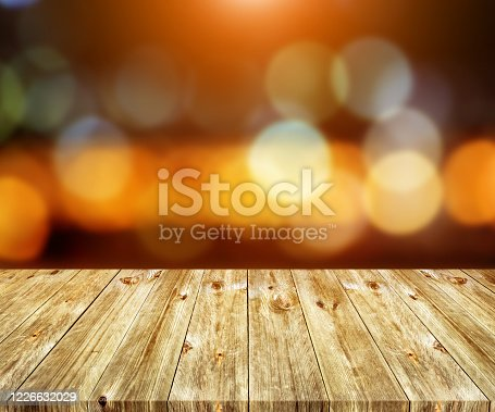 Old brown wooden plank with abstract blurred bokeh light backgrounds