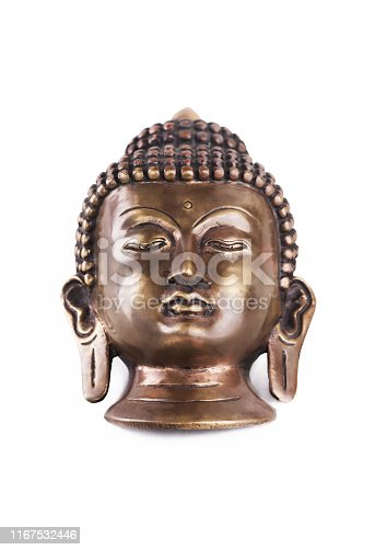 Buddha Shakyamuni's head. The old mask made of metal isolated on a white background.