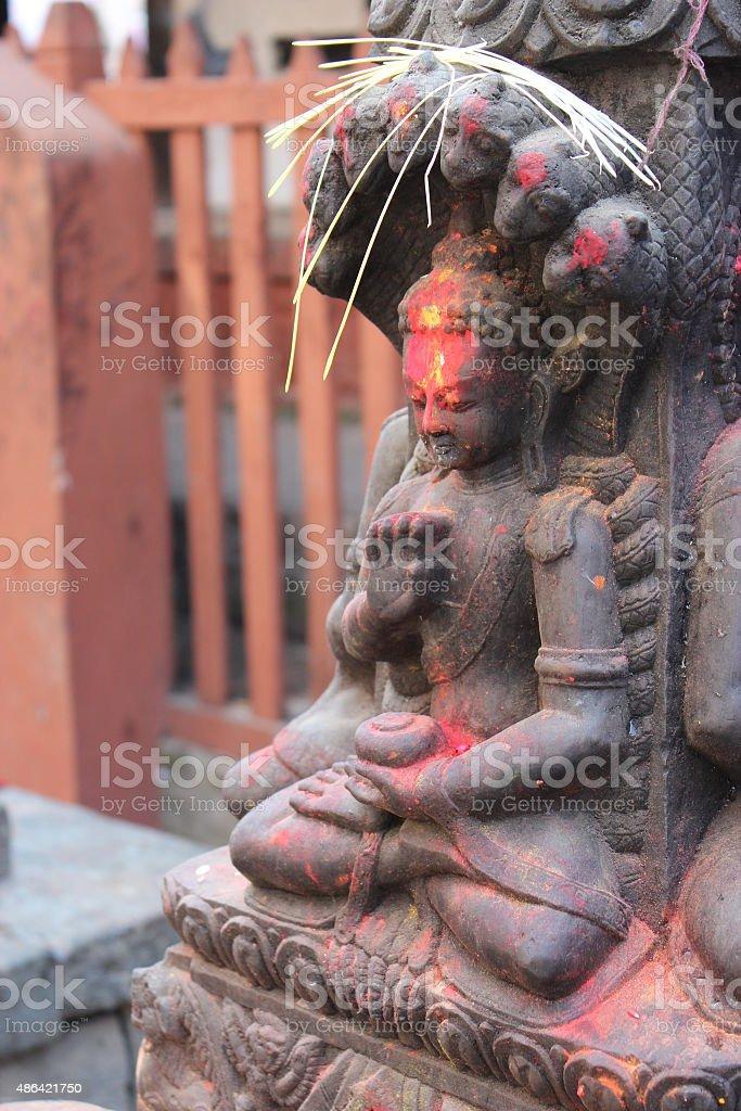 Old Buddha statue with seven naga stock photo