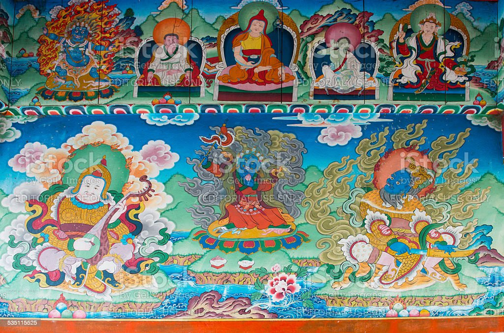Old buddhist fresco at the gate of Chame village stock photo