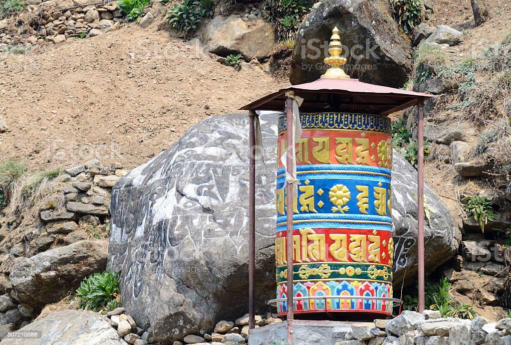 Old buddhist mani stones prayer wheels with sacred mantras ,Nepal stock photo