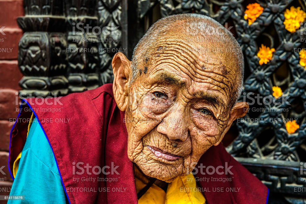 Old buddhist nun in Kathmandu, Nepal stock photo