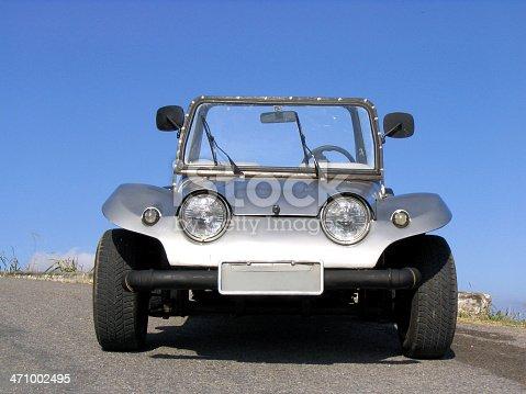An old buggy against blue sky
