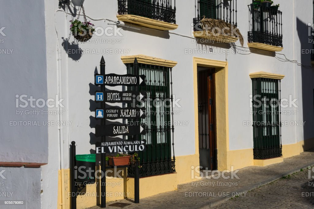 Old building and a sign with touristic places stock photo