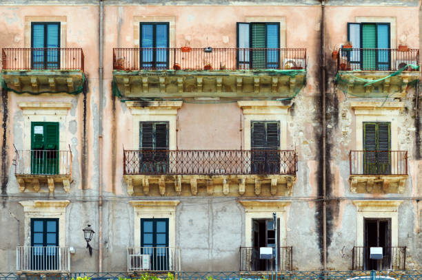 Old building façade in Sicily stock photo
