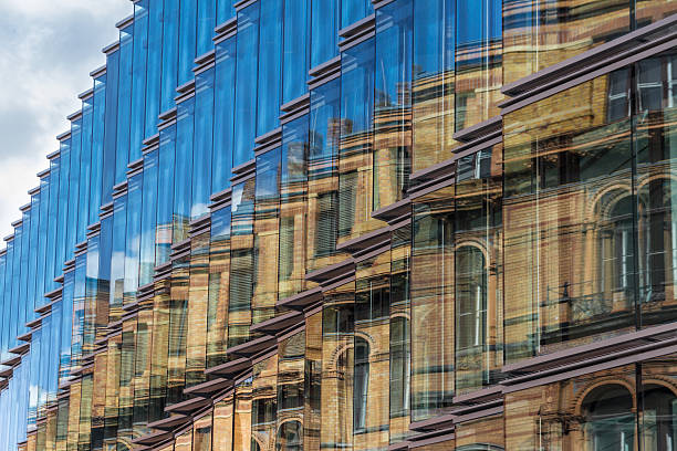 old building facade reflection in modern building glass facade - historic vs new stock photos and pictures