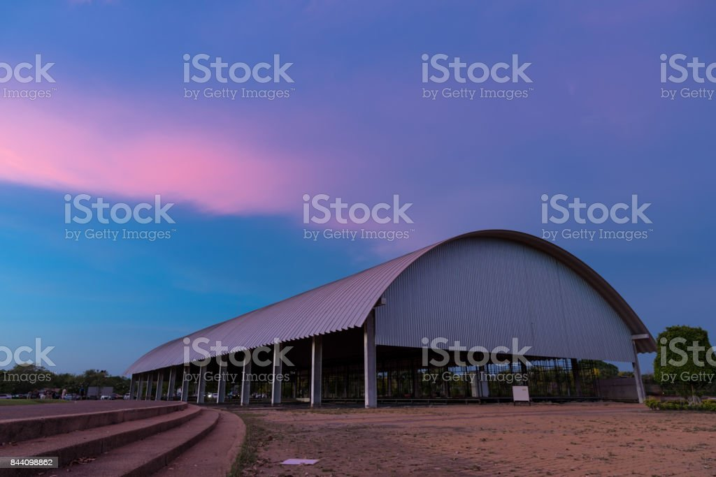 Old building factory under the twilight sunset purple sky. stock photo
