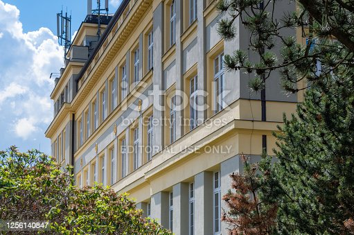 Liberec, Liberec Region, Czech Republic - June 26, 2020: Low angle view of tree against the building of the Faculty of Textile of the Technical University of Liberec.