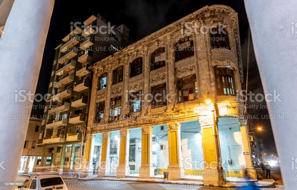 Old building lit up at night in old town Havana stock photo