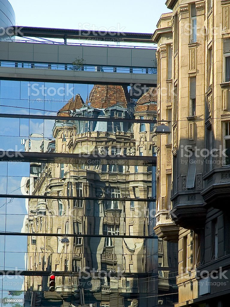 old building reflect in new 1 stock photo