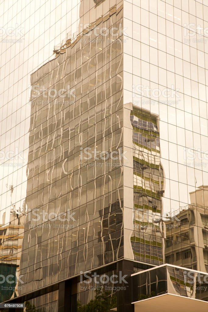 Old building reflextions on a modern glass building stock photo