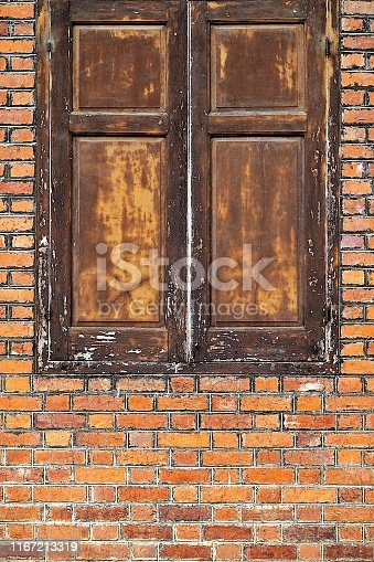 Old building walls over 100 years old old brick old door old window not old