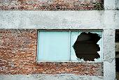 Old building with broken window.
