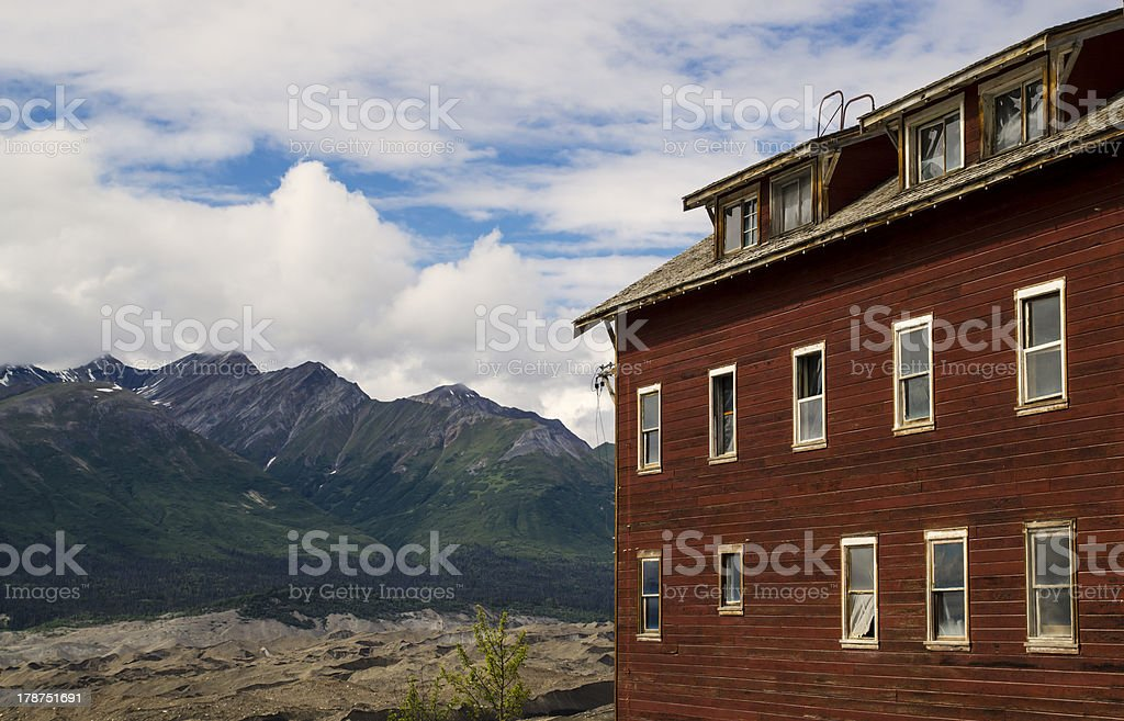 Old building with mountains. stock photo