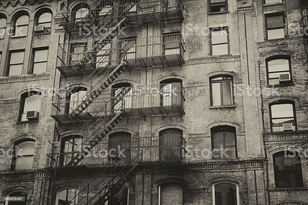 Old building with outdoor stairs in New York City stock photo