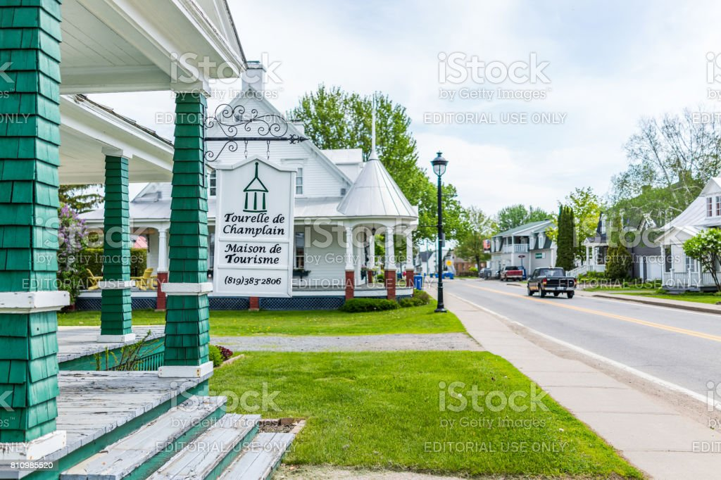 Old building with tourism center sign in small town on Chemin du Roy with unique architecture stock photo