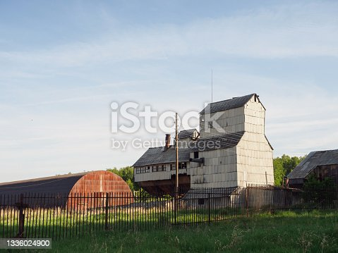 istock Old buildings for grain storage. Storage of grain crops, such as wheat or rice 1336024900