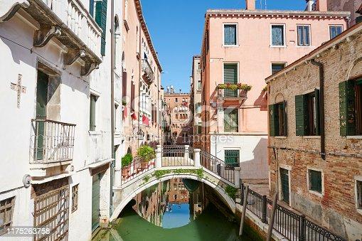 A very old pedestrian bridge in Calle dei Frati crossing over Rio de Sant'Anzolo. Venice. Veneto. Italy.