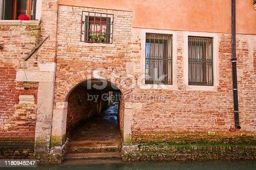 Sea access to a very old buildings in Sestiere San Marco. Venice. Veneto. Italy.
