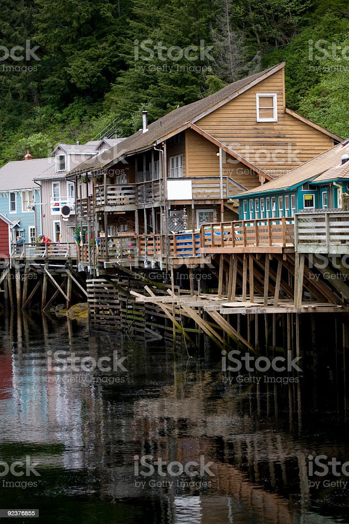 Old Buildings Sit Over River in Ketchikan Alaska royalty-free stock photo