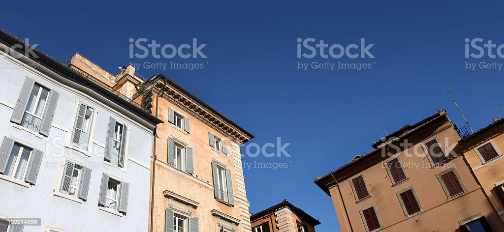 Old buildings skyline in downtown Rome, Italy, with blue sky stock photo