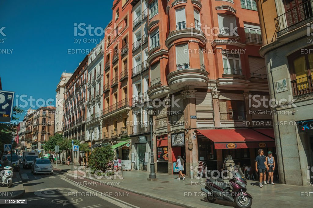 Madrid, Spain - July 24, 2018. Old buildings with shops and people...
