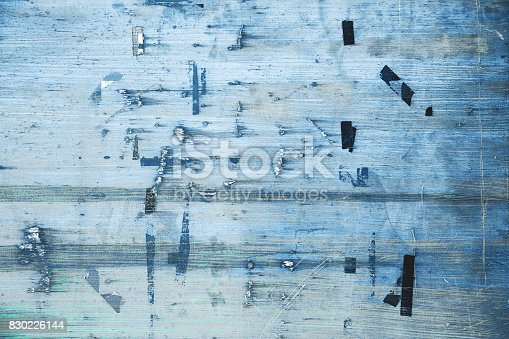 istock Old bulletin board in blue color. Billboard with torn peeled poster. 830226144