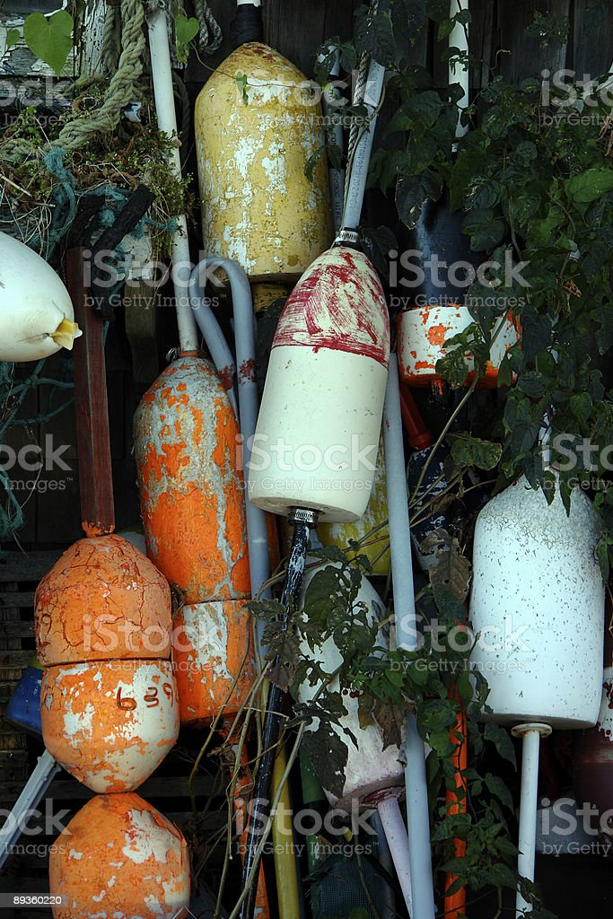 Old buoys on  another wall at fishing shack royaltyfri bildbanksbilder