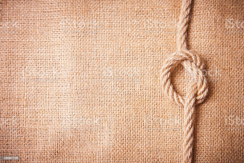 Old burlap and knot stock photo
