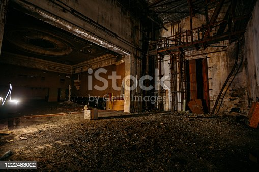 istock Old burnt creepy abandoned ruined haunted theater 1222483022
