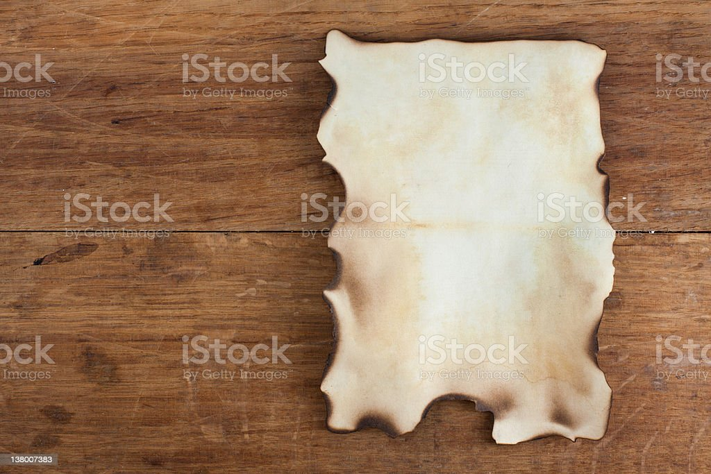 Old Burnt Paper on Wood background royalty-free stock photo
