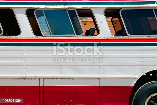 Side view of typical Mexican bus parked in small village