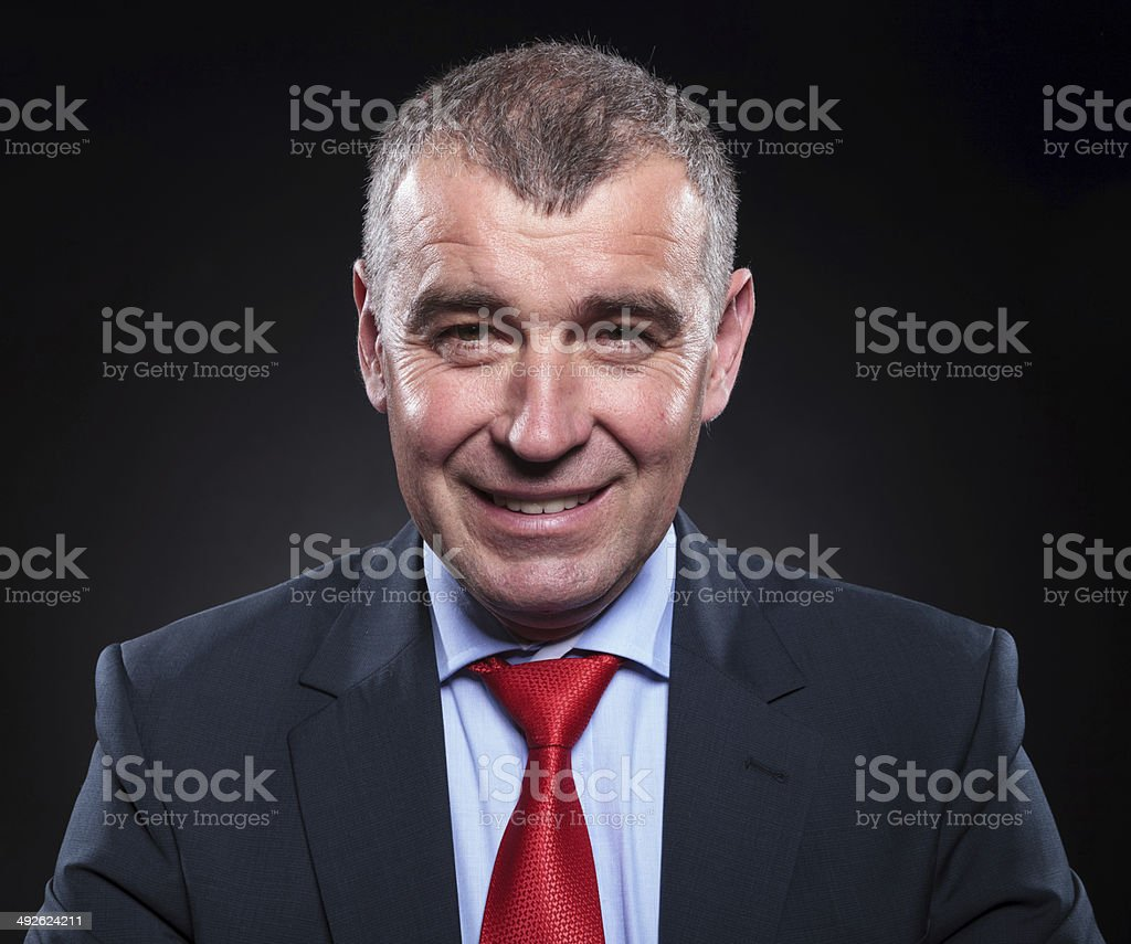 old business man smiles stock photo