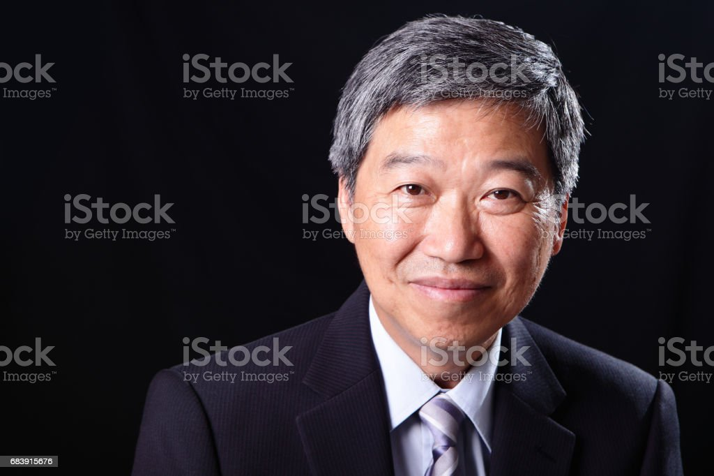 old businessman smile happily stock photo