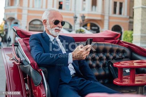 Business man looking at mobile phone
